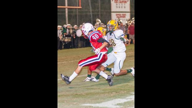 Almost got there - 2014. Bowen Tiller (48) hauls in a pass for a 41-yard gain on the last play of the first half against Laurens in the 2014 rivalry game at Wilder Stadium, but three Raider defenders stop the Red Devil receiver four yards short of the end zone. A score would have tied the game at 14 going into halftime. Laurens went on to win, 24-7. A photo gallery of 2016 Clinton High and Presbyterian College pre-season football is on MyClntonNews.com. - Photo by Fletcher Pruitt Jr.