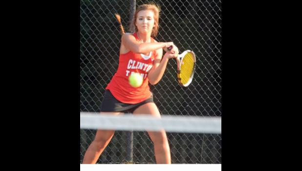 Making the return. Clinton High girls tennis junior Elizabeth Jones hits a return during a recent match at the red courts at the North Adair Street athletic complex. Jones won her singles matches in recent region play against Woodruff and Chapman, as the Red Devils have extended their region mark to 5-1. - Photos by Vic MacDonald